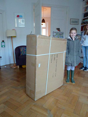 The box next to a nine year old (who hasn't been told she might be fitted into it)